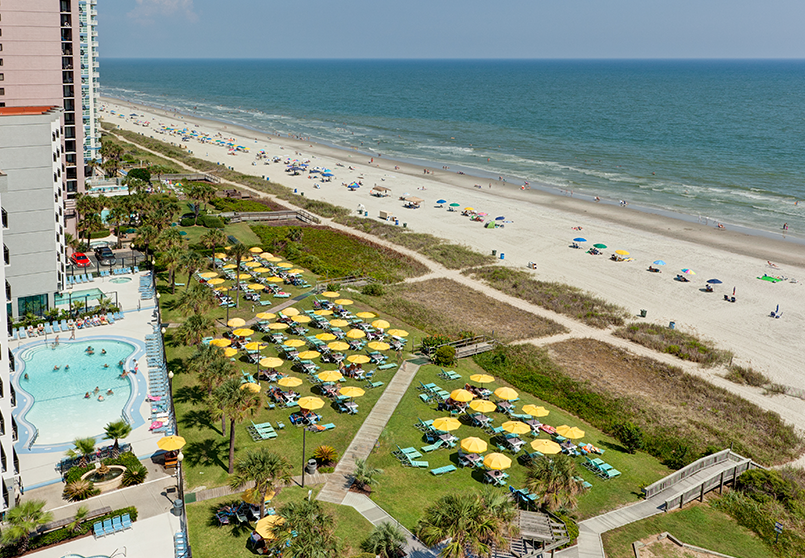Enjoy the warm rays of the sun and the crisp sea air lounging around on our oceanfront lawn with our iconic yellow umbrellas.
